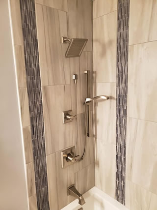 A Beautiful Tile and Marble Shower Installed By Star Remodeling